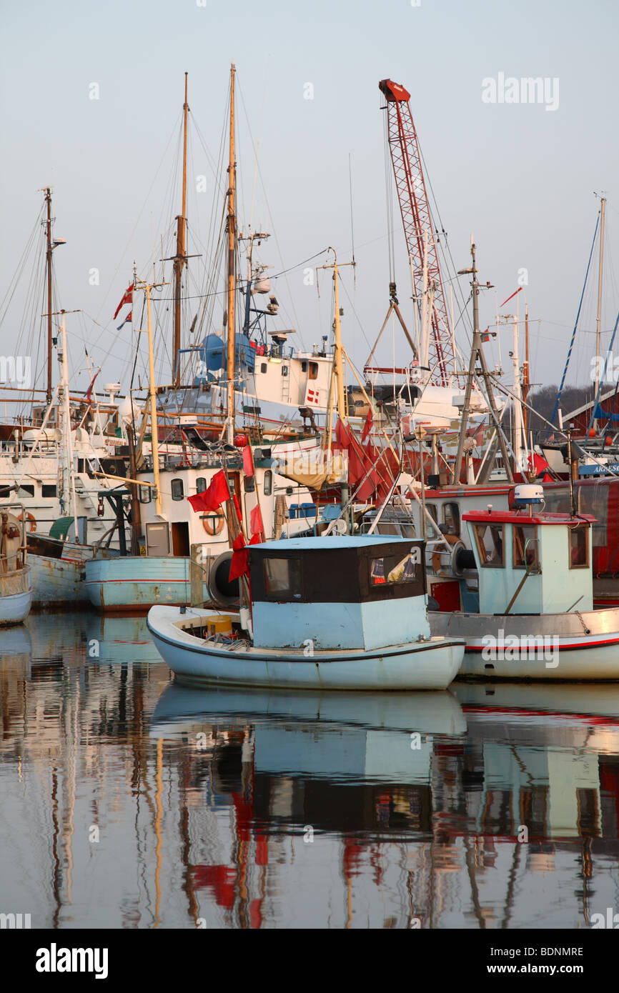 Evening atmosphere in Gilleleje Harbour in the North Zealand, Denmark. Reflections of the boats in the water. - Stock Image
