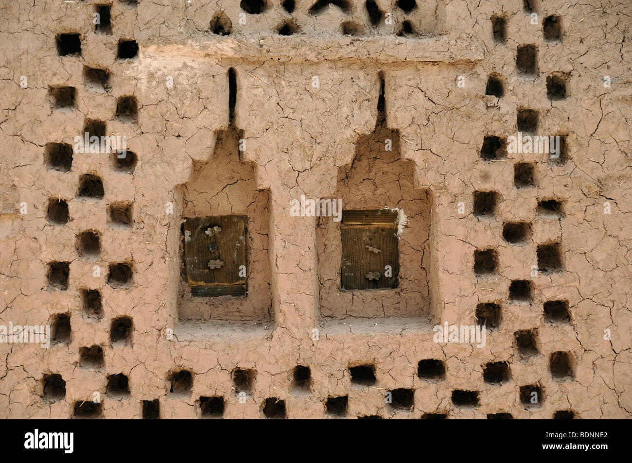 Decorative Adobe Mud Earth Window Openings At Benhaddou Kasr or Kasbah, Morocco - Stock Image