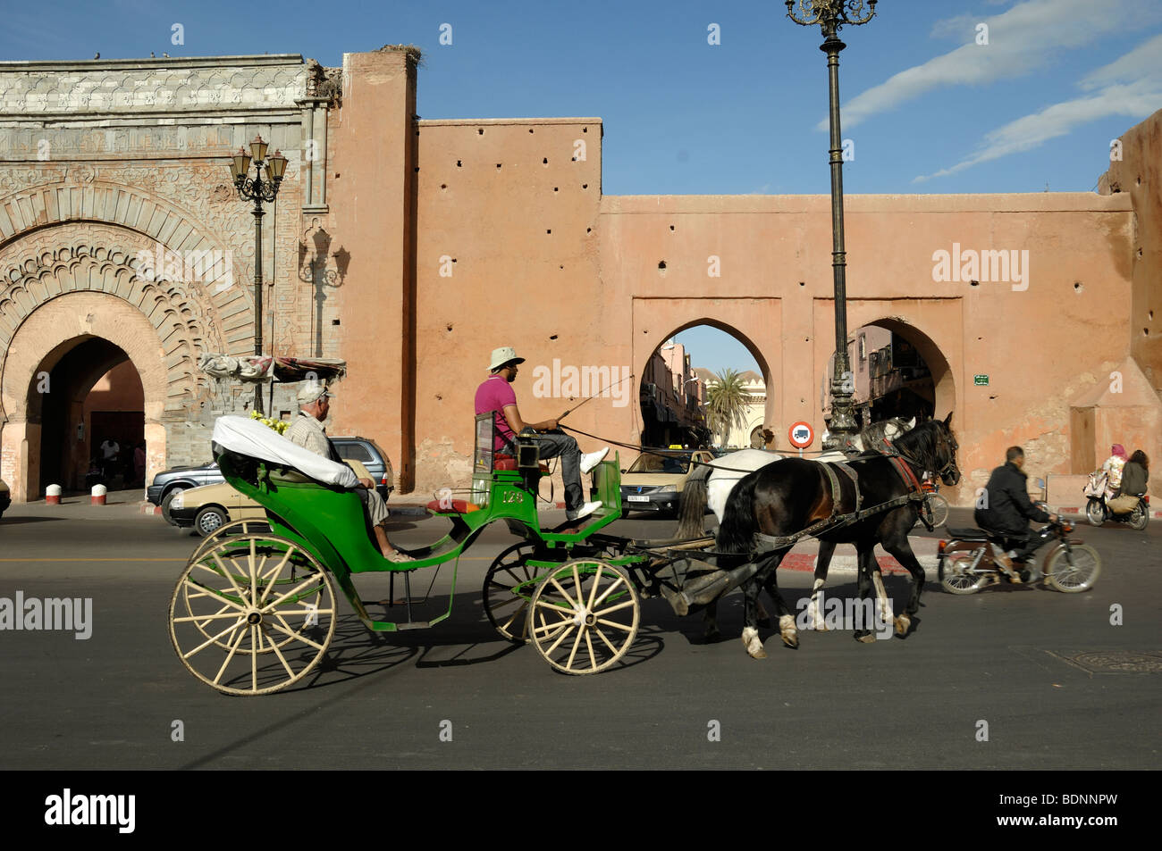 Bab Agnaou City Gate in the City Walls with Tourists Sightseeing in a Horse & Carriage or Hackney Cab, Marrakesh, - Stock Image