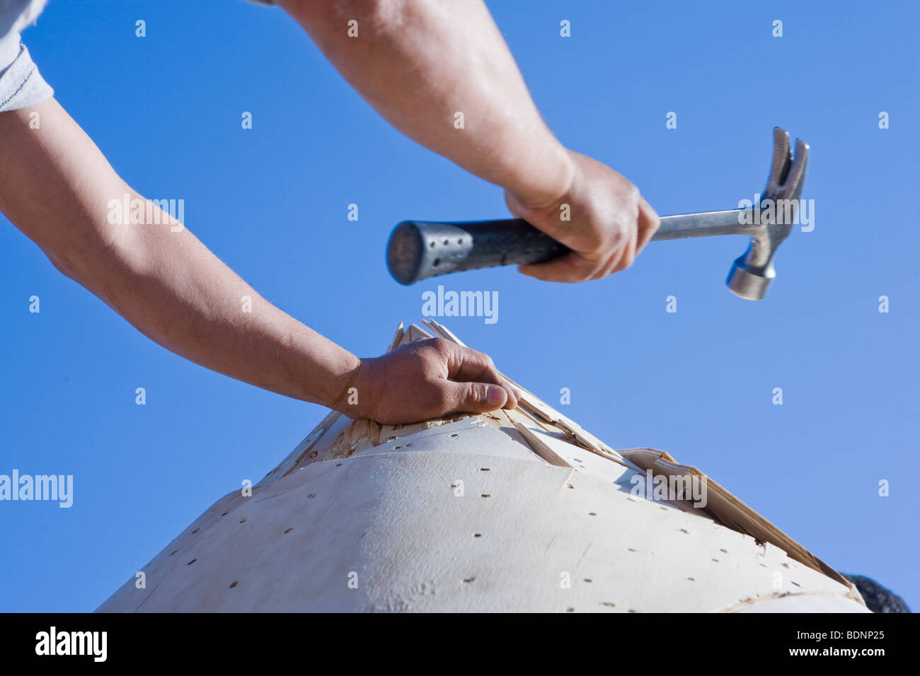 Carpenter working on the turret of a house - Stock Image