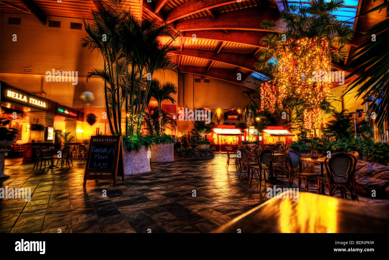 Evening eatery romantically lit with the lighting reflected in a checkered tiled floor Stock Photo
