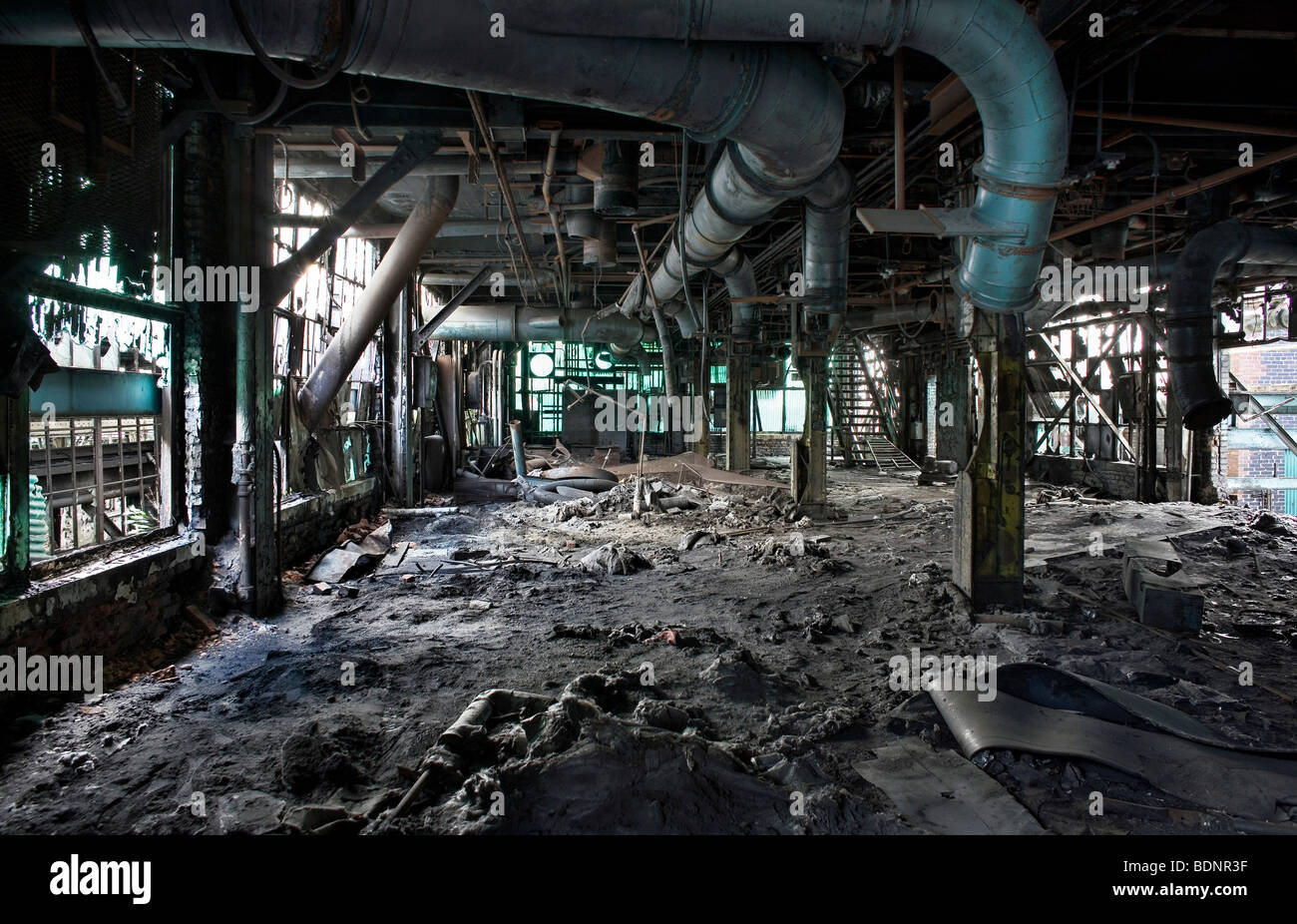 Interior view of a derelict factory - Stock Image