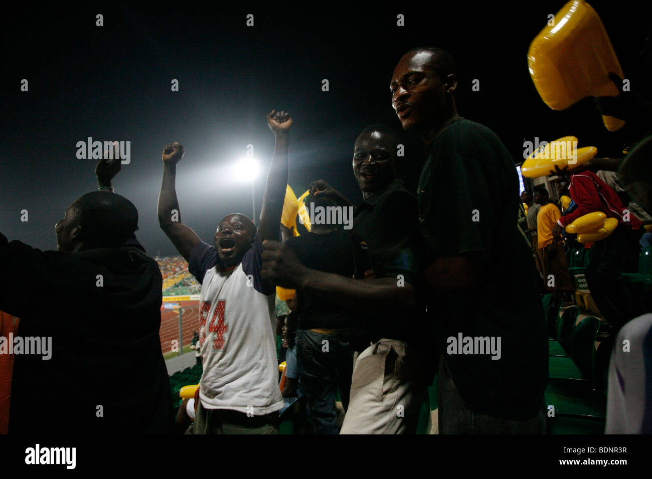 Ivory Coast Fans and supporters cheer a goal. 3rd place match between Ghana and Ivory Coast. African Cup of Nations. - Stock Image