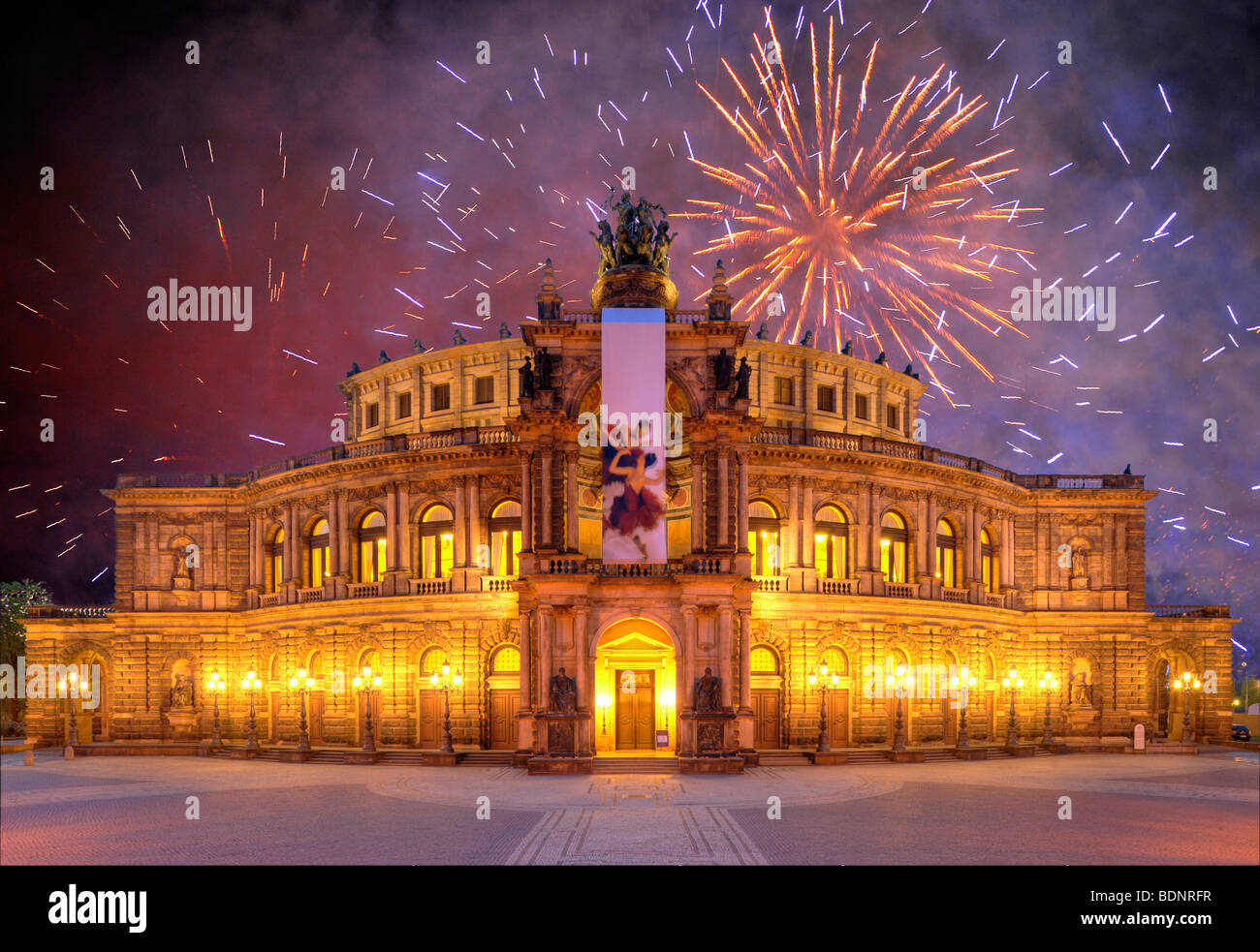Semperoper opera, with banners, at Theaterplatz square, fireworks, Dresden, Saxony, Germany, Europe - Stock Image