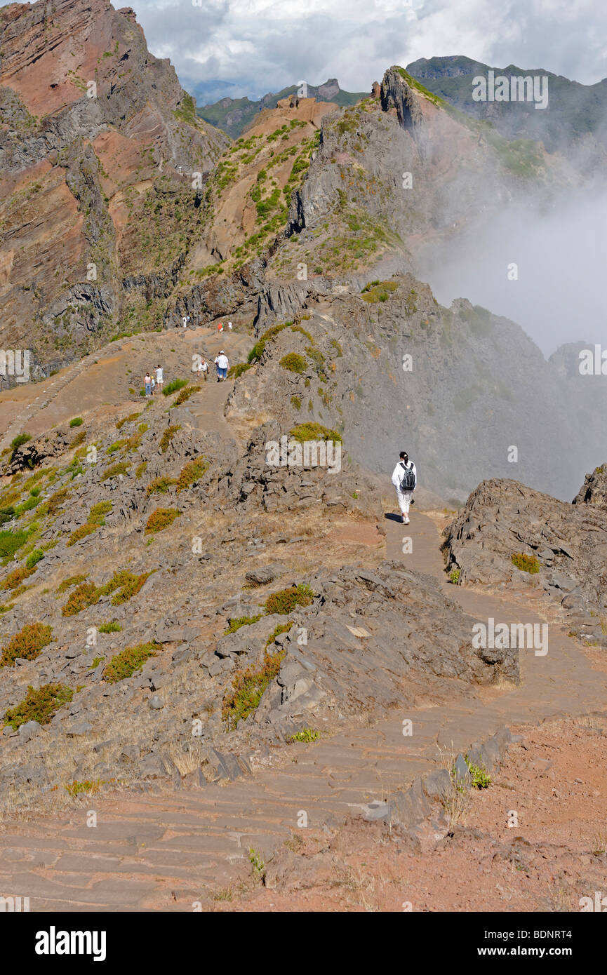 Hikers on the hiking trail of Pico do Areeiro, leading to the neighboring peaks, Madeira, Portugal, Europe - Stock Image