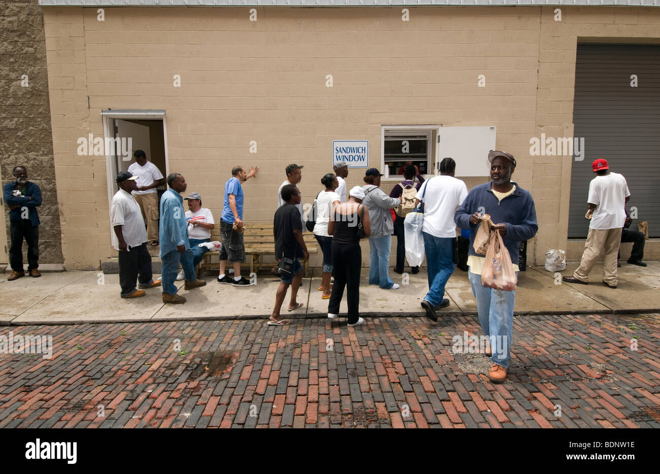 People queing at Sandwich window, Cincinnati, OH, Over the Rhine, area of redevelopment, - Stock Image