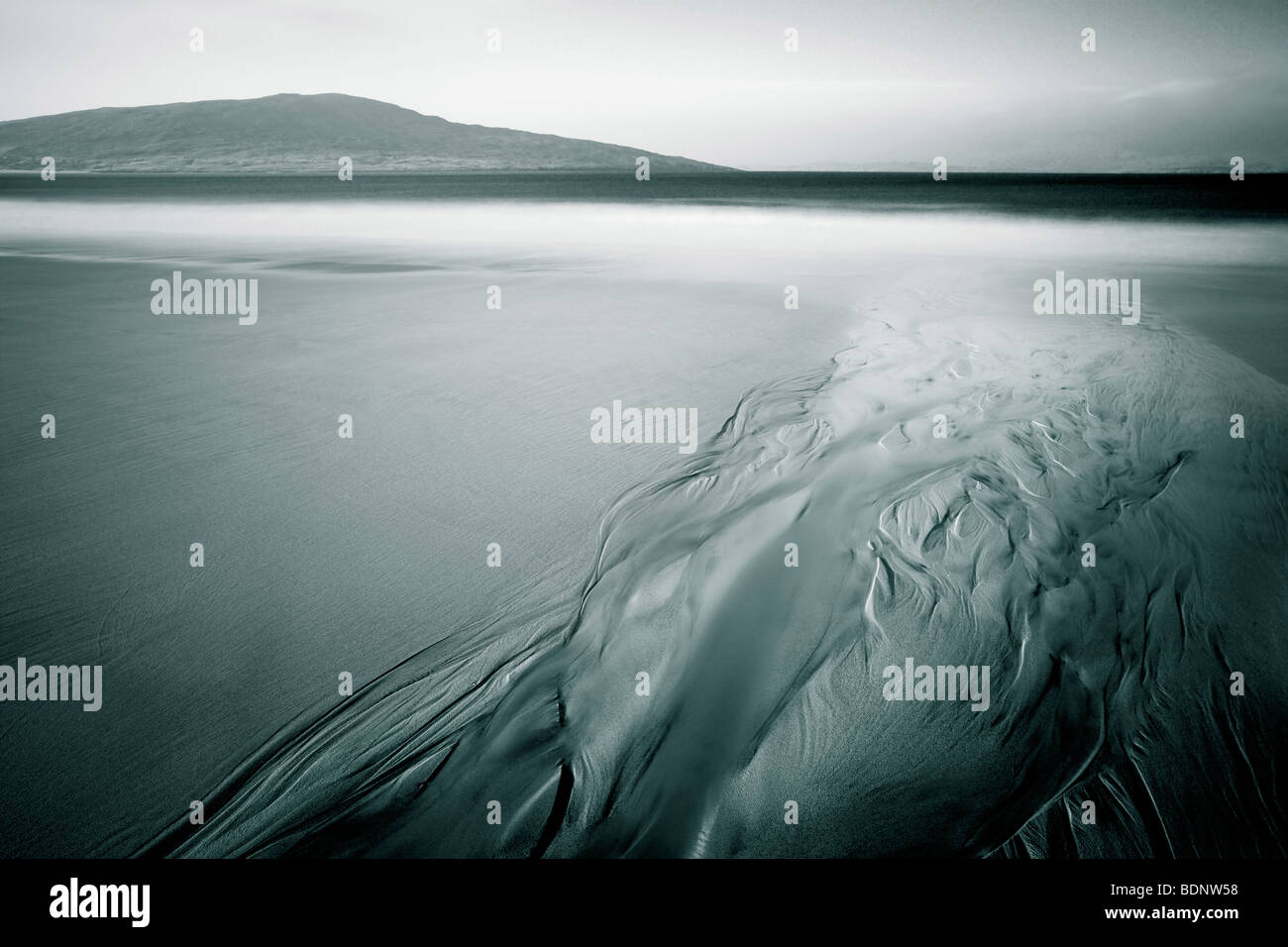 The flow of water in sand - Stock Image