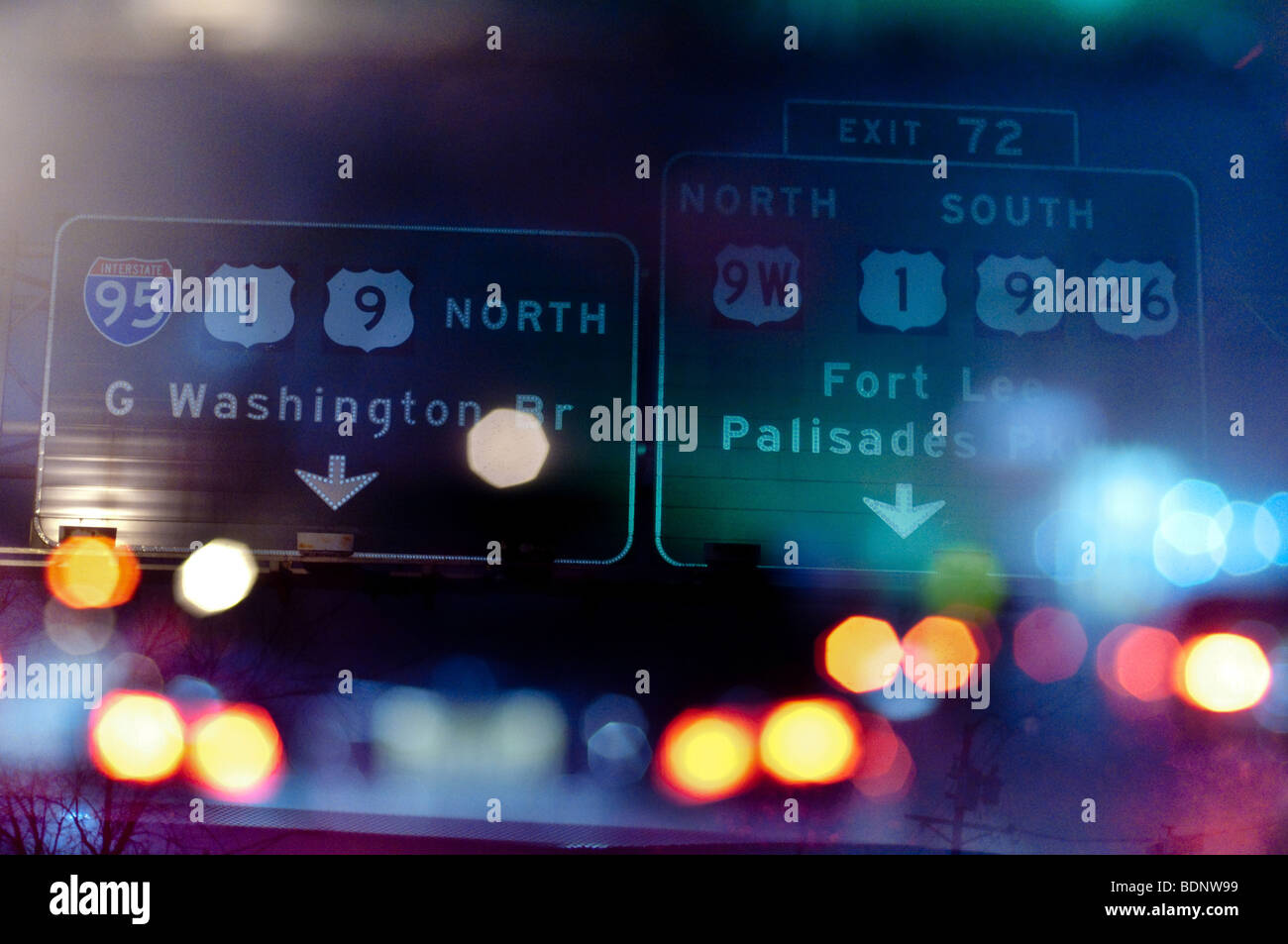 Highway signs and lights - Stock Image