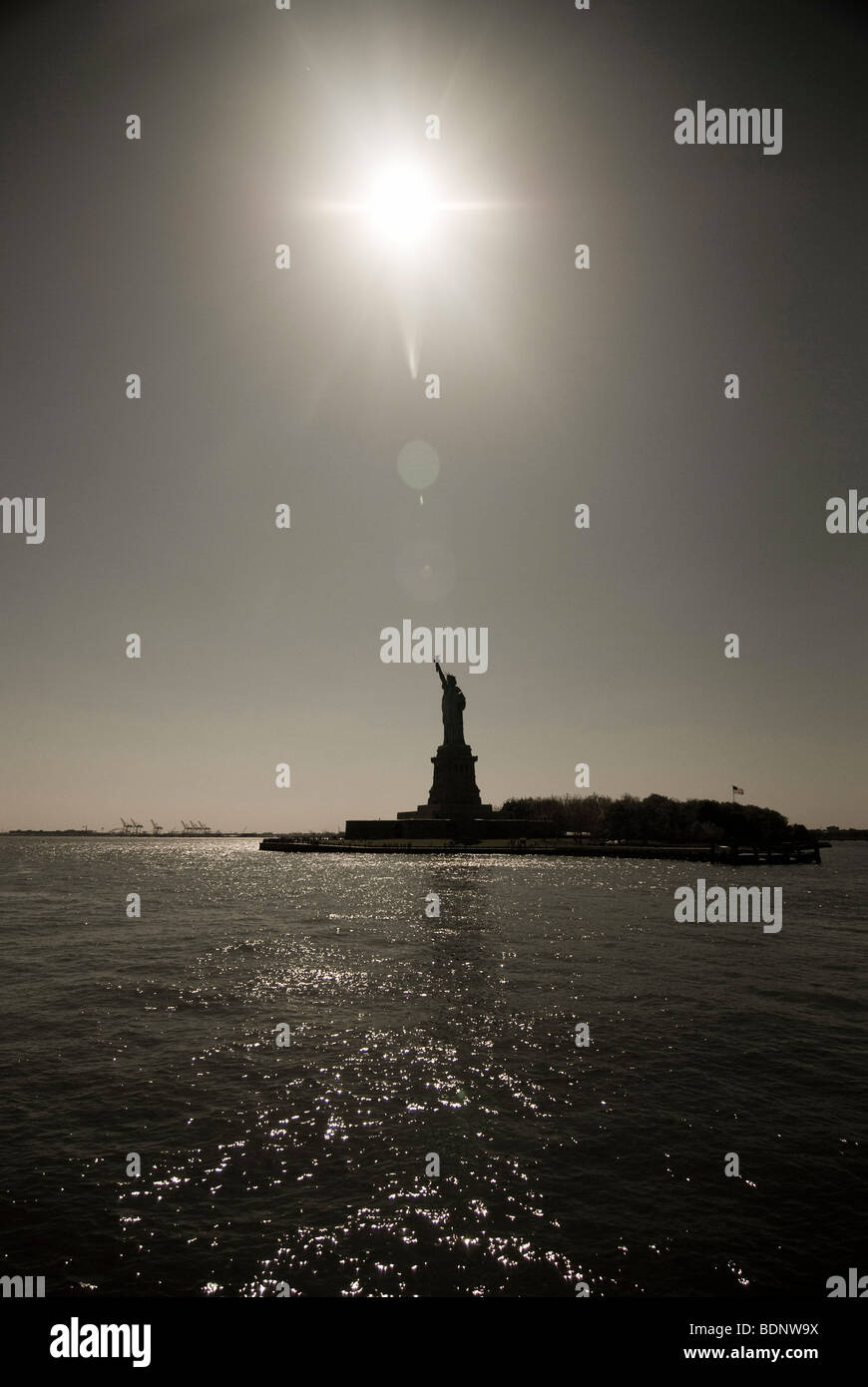 The Statue of Liberty seen from the water in New York Harbor, USA. - Stock Image