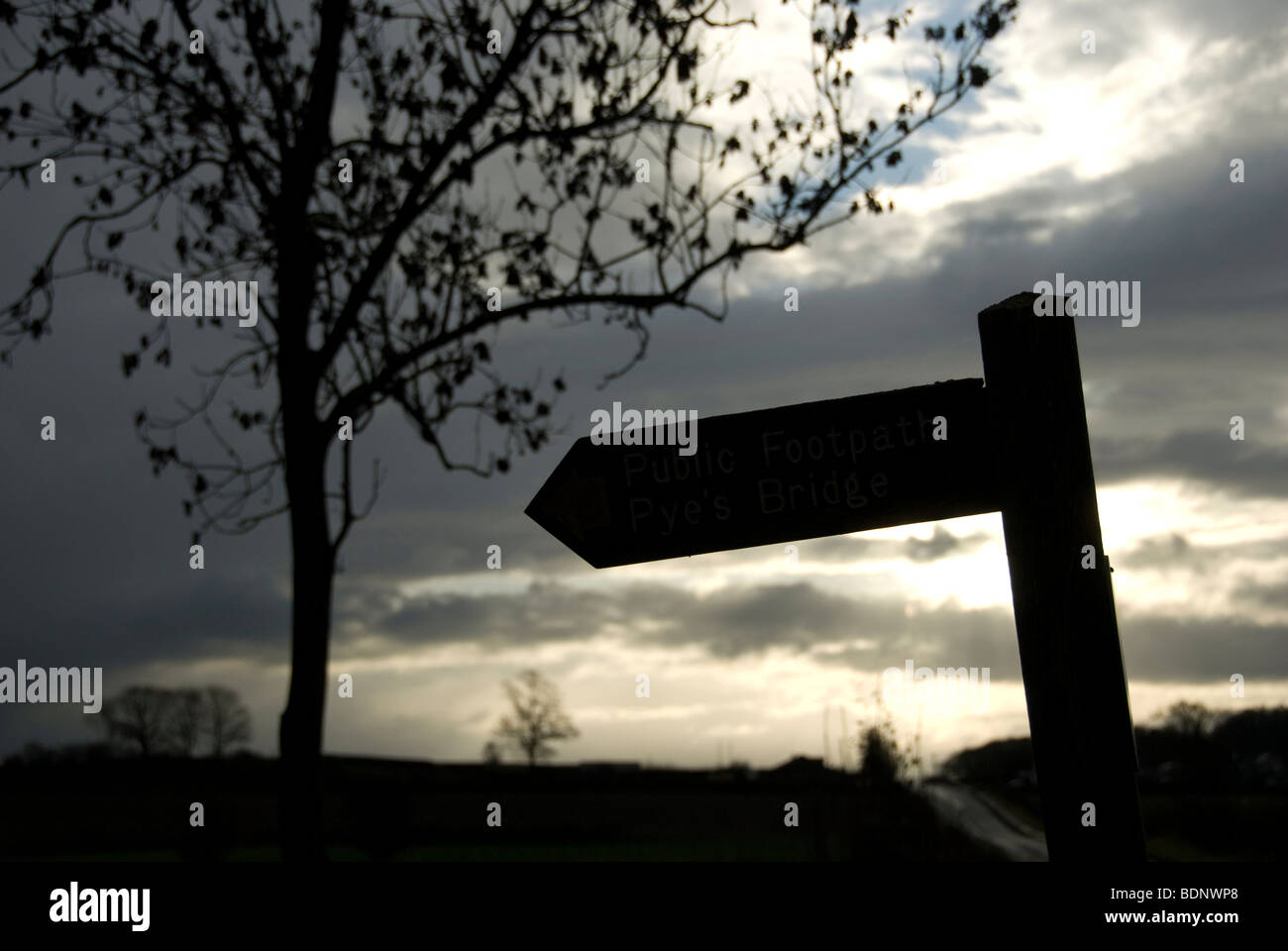 Silhouette of a bridleway sign - Stock Image