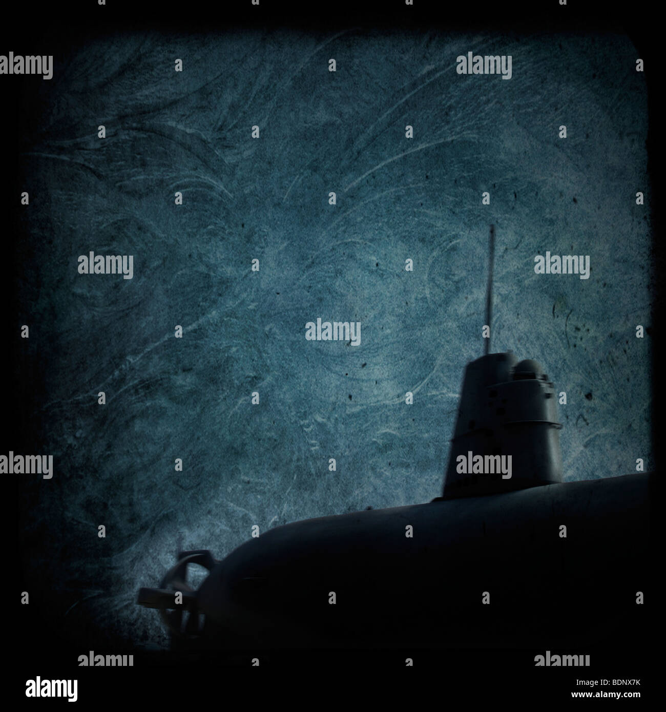 A dark submarine under water - Stock Image