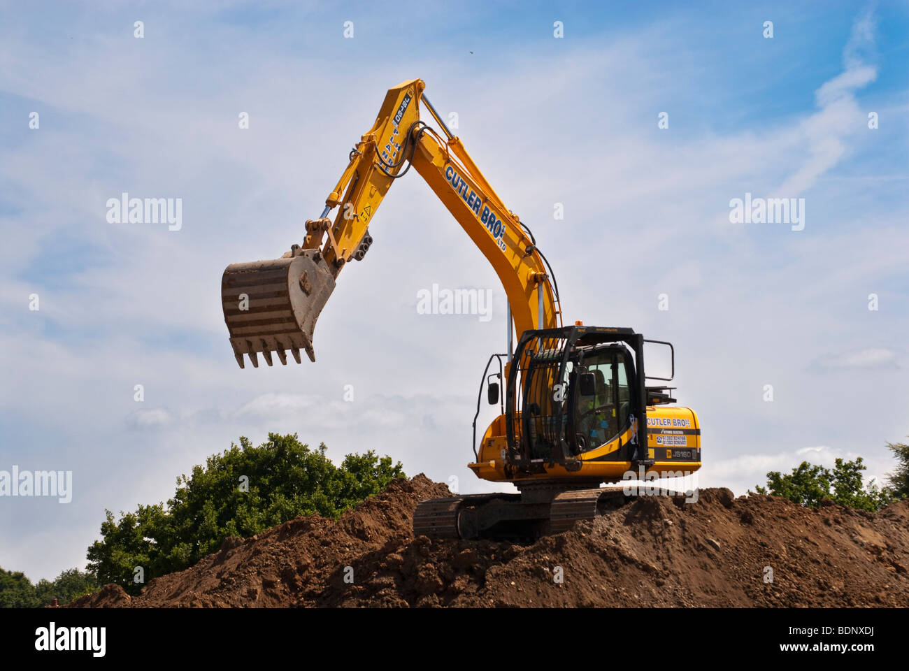 Earth moving digger on building site - Stock Image