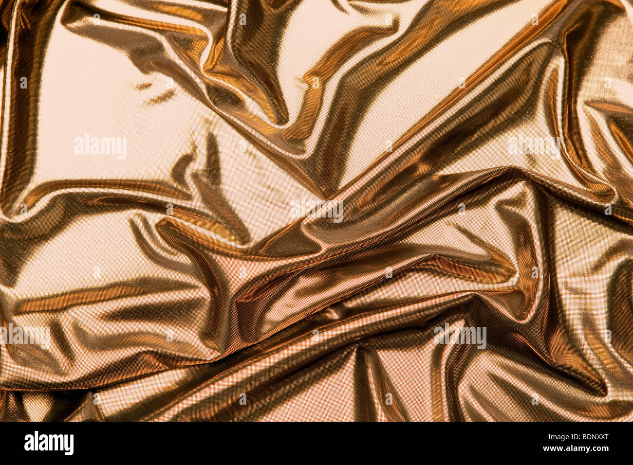 Gold metallic fabric - Stock Image