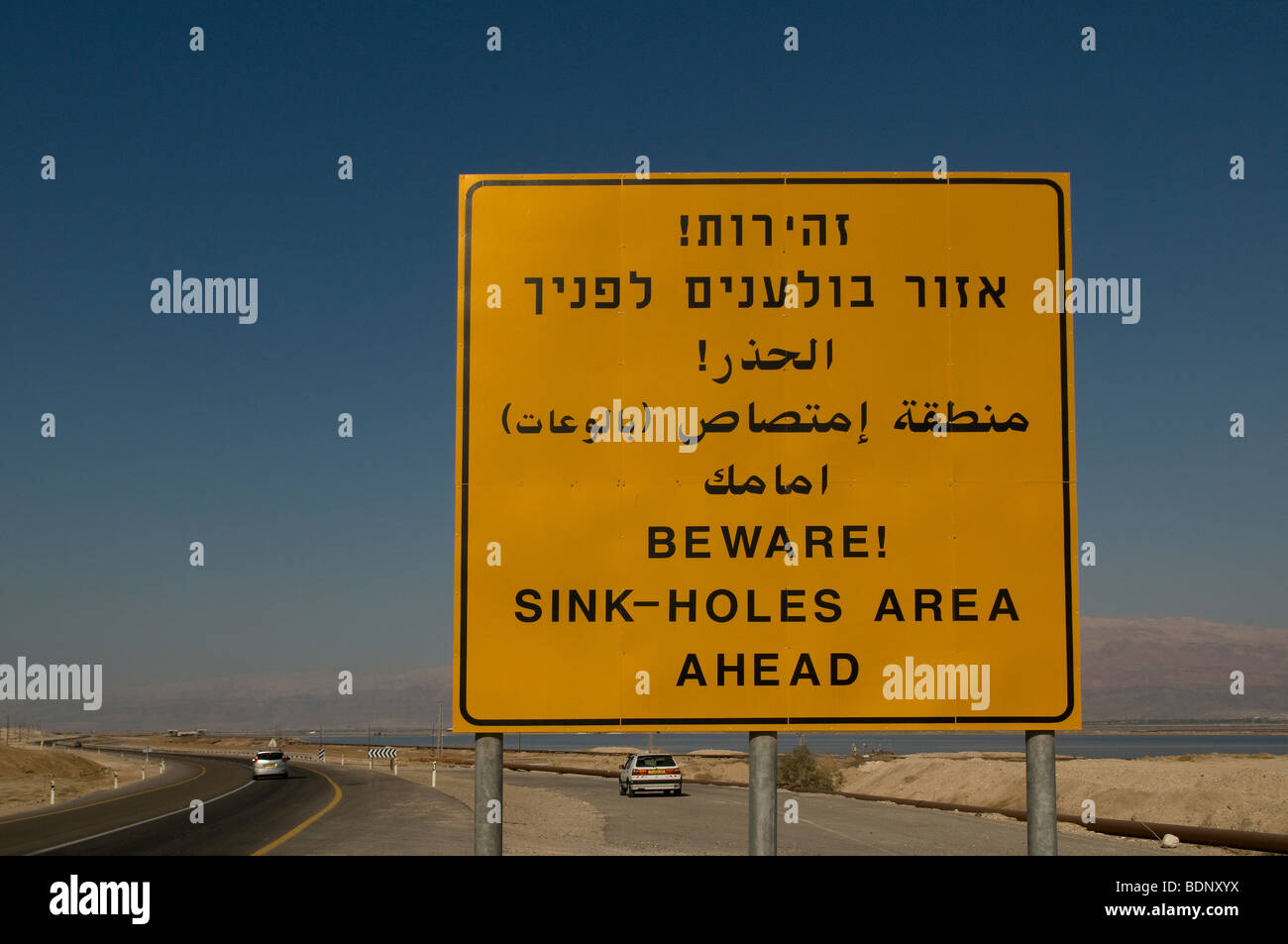 Warning sign for sinkholes at the Dead Sea coast in Israel - Stock Image