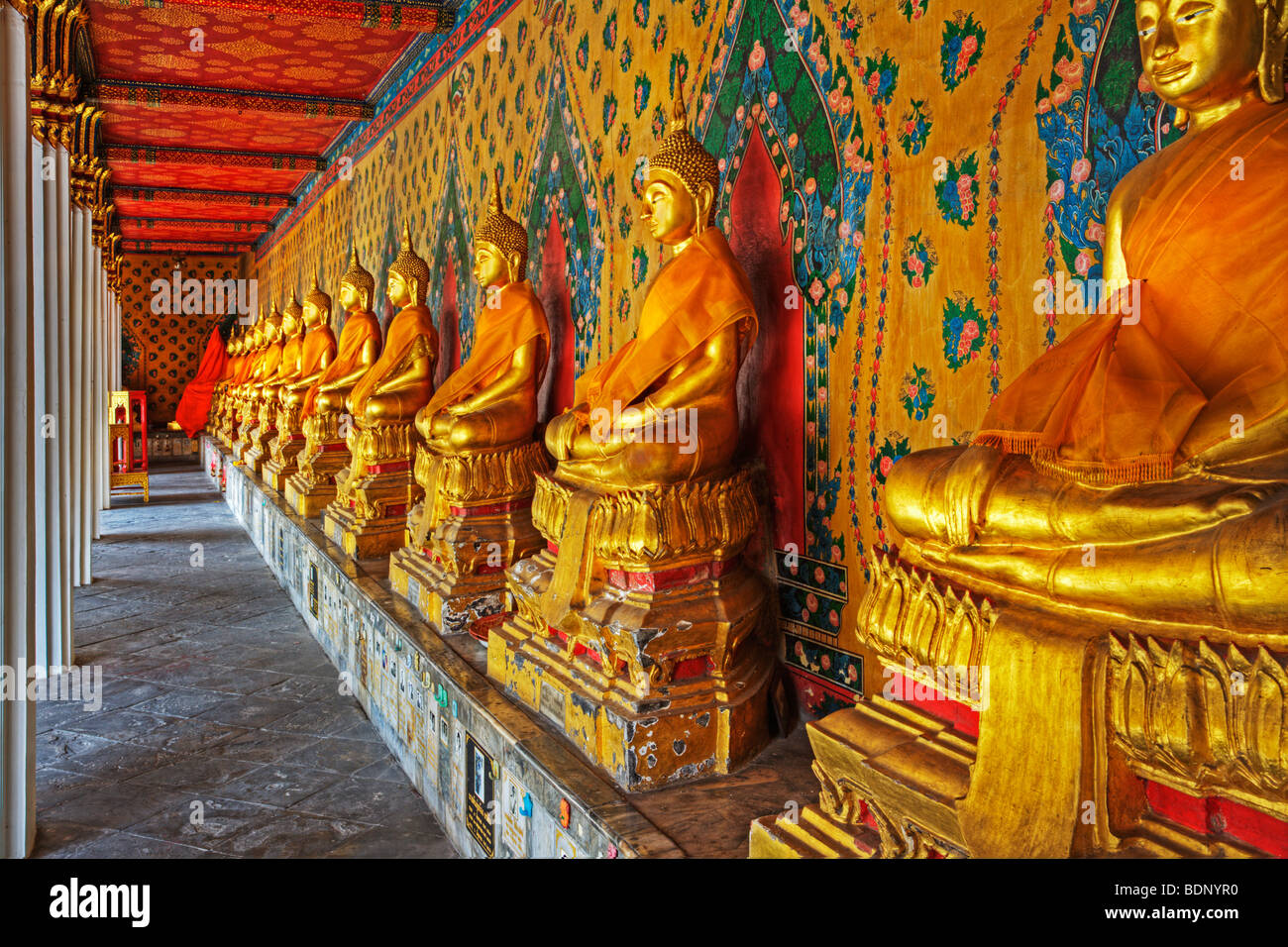 Buddhas located in the Gallery of the Bot at Wat Arun - Stock Image