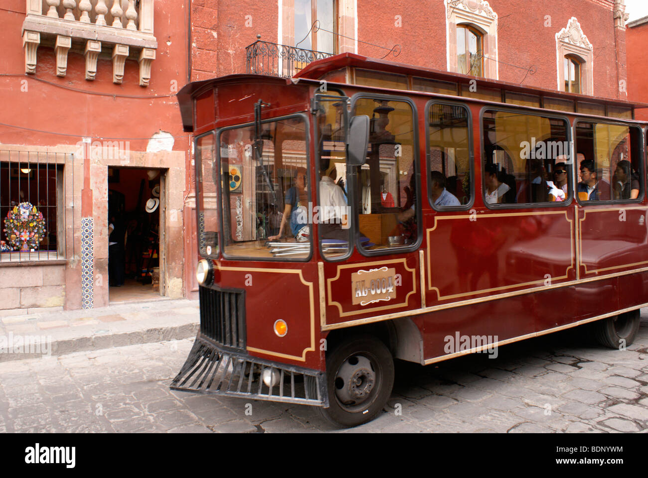 Sightseeing trolley bus on a street in San Miguel de Allende, Guanajuato, Mexico - Stock Image