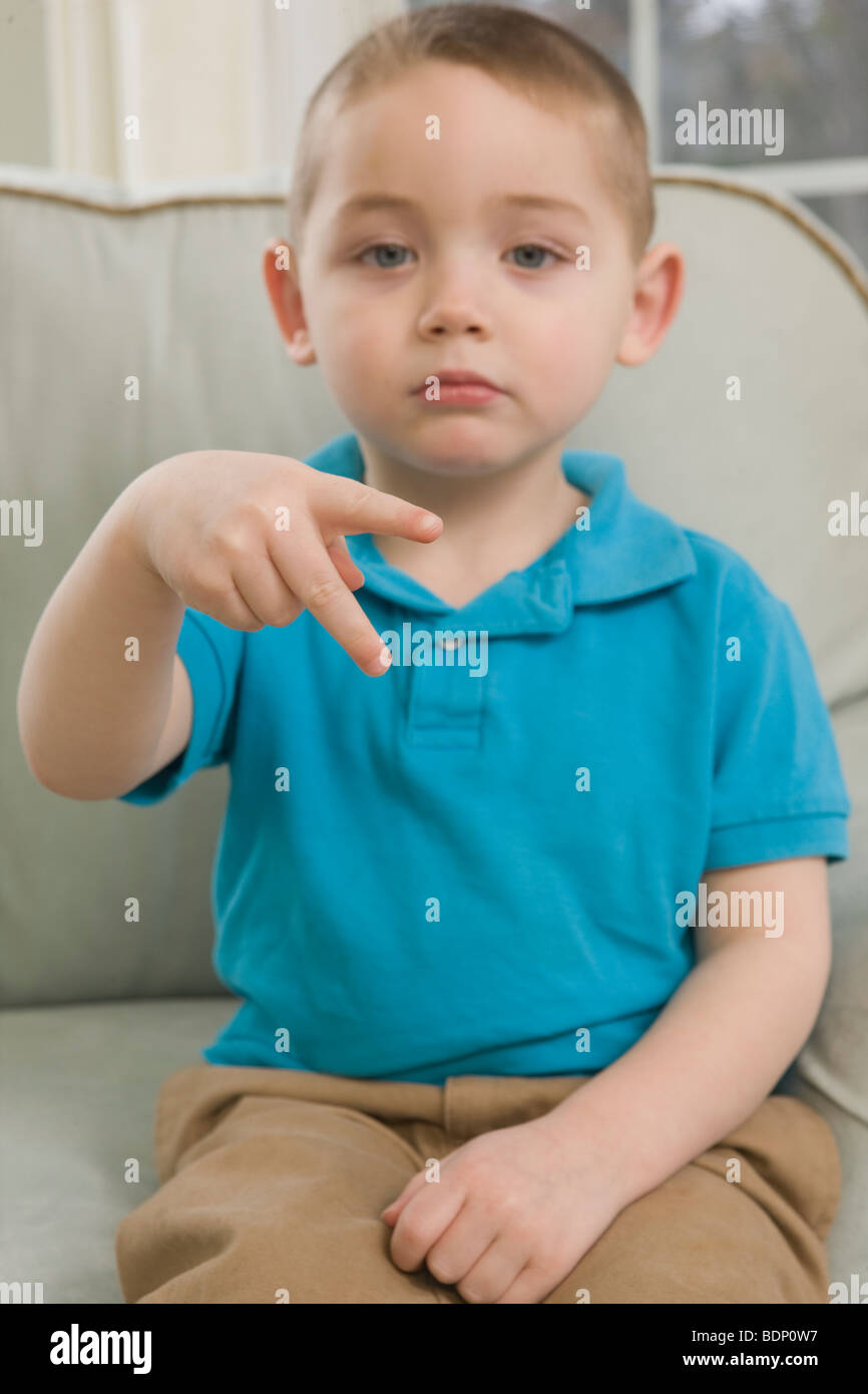Boy signing the letter 'P' in American Sign Language - Stock Image