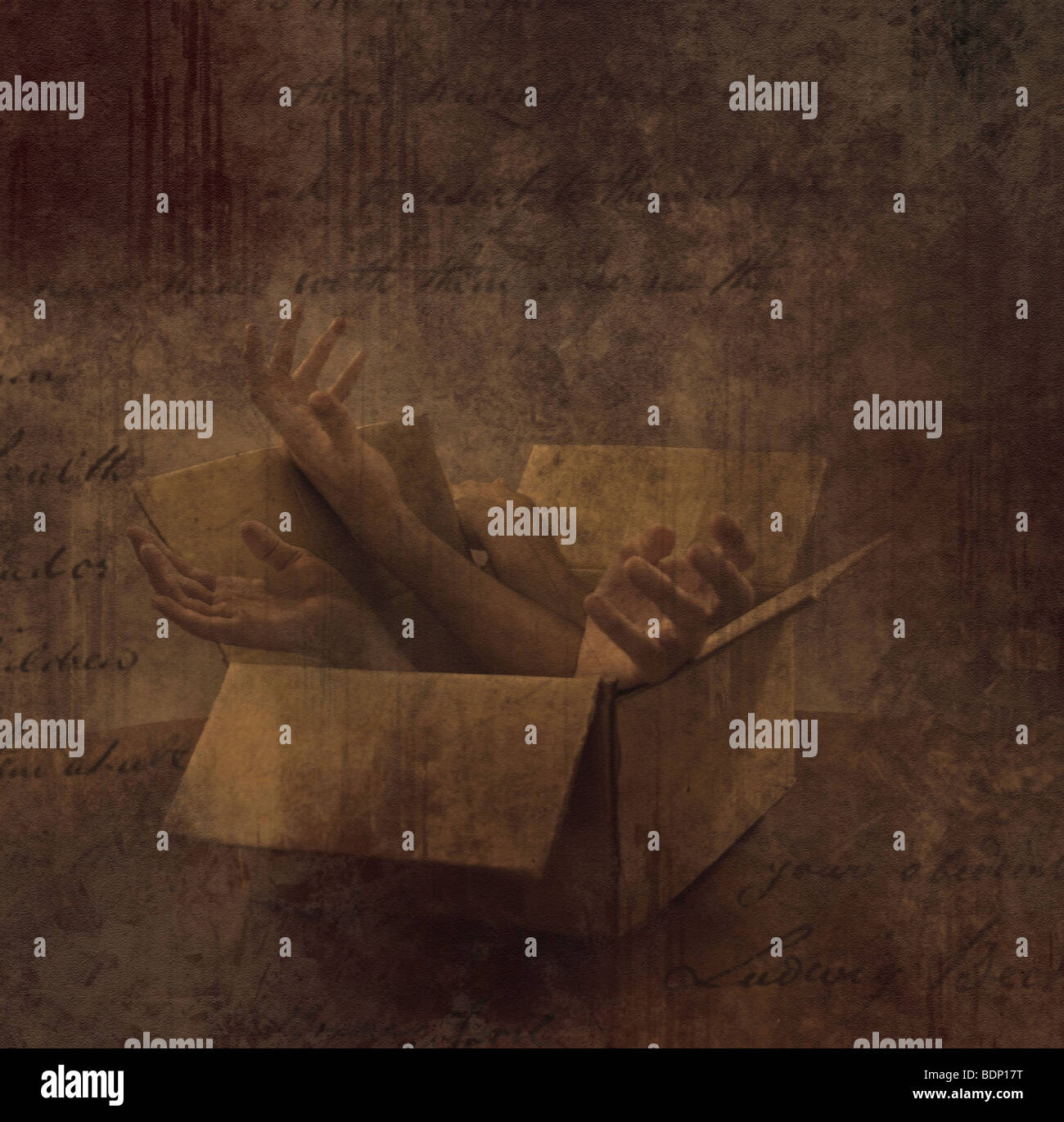 Limbs in a small box with montaged hand writing - Stock Image