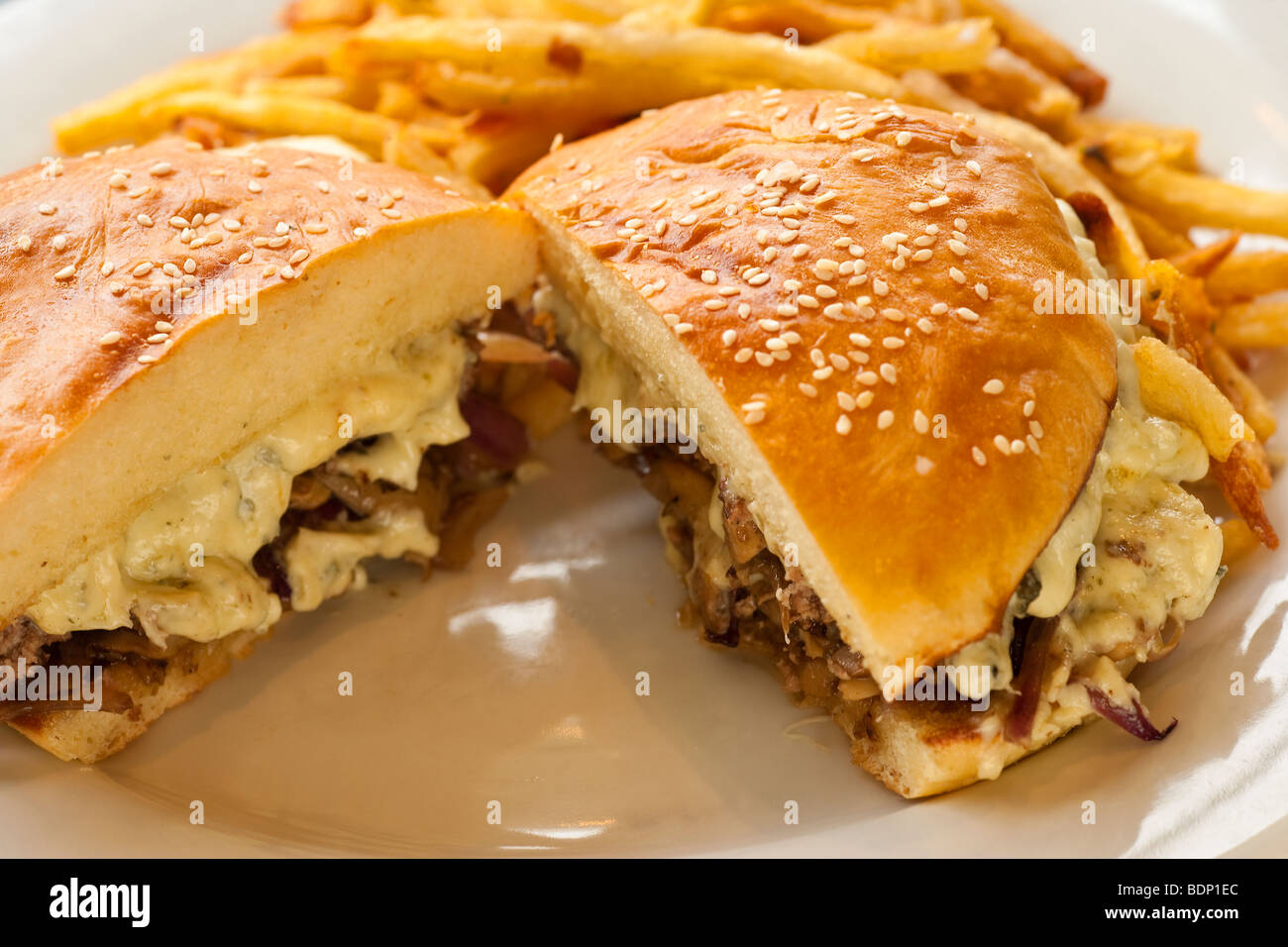 Big Blue Burger with grilled mushrooms, red onions and Gorgonzola cheese with french fries, Restaurant Jane, Santa - Stock Image