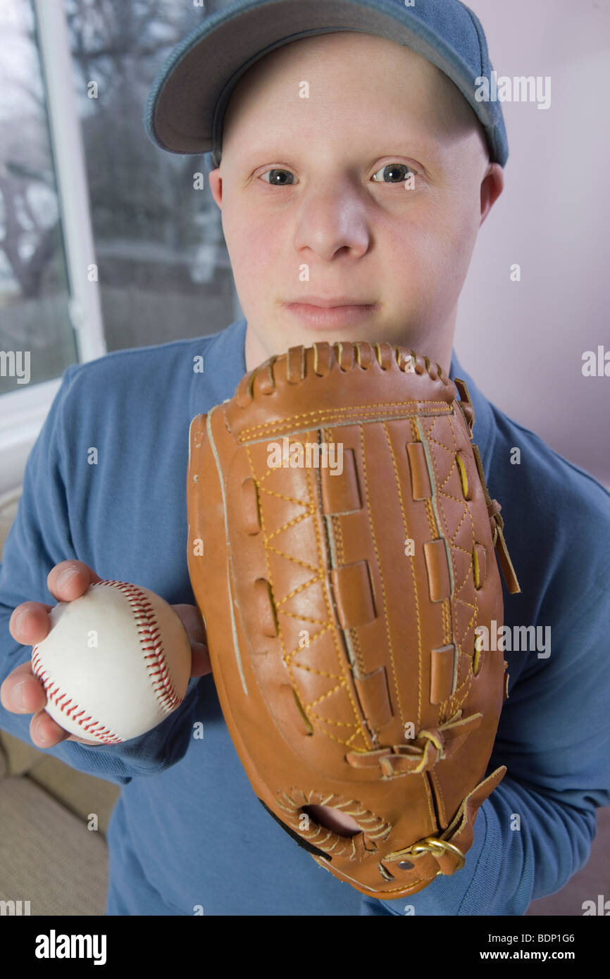 Man with a baseball glove and a baseball - Stock Image