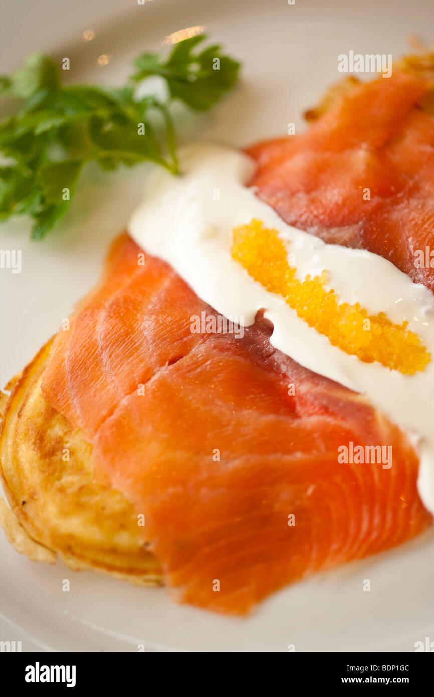 goat cheese pancakes with smoked salmon and golden caviar, Restaurant Jane, Santa Barbara, California, United States - Stock Image