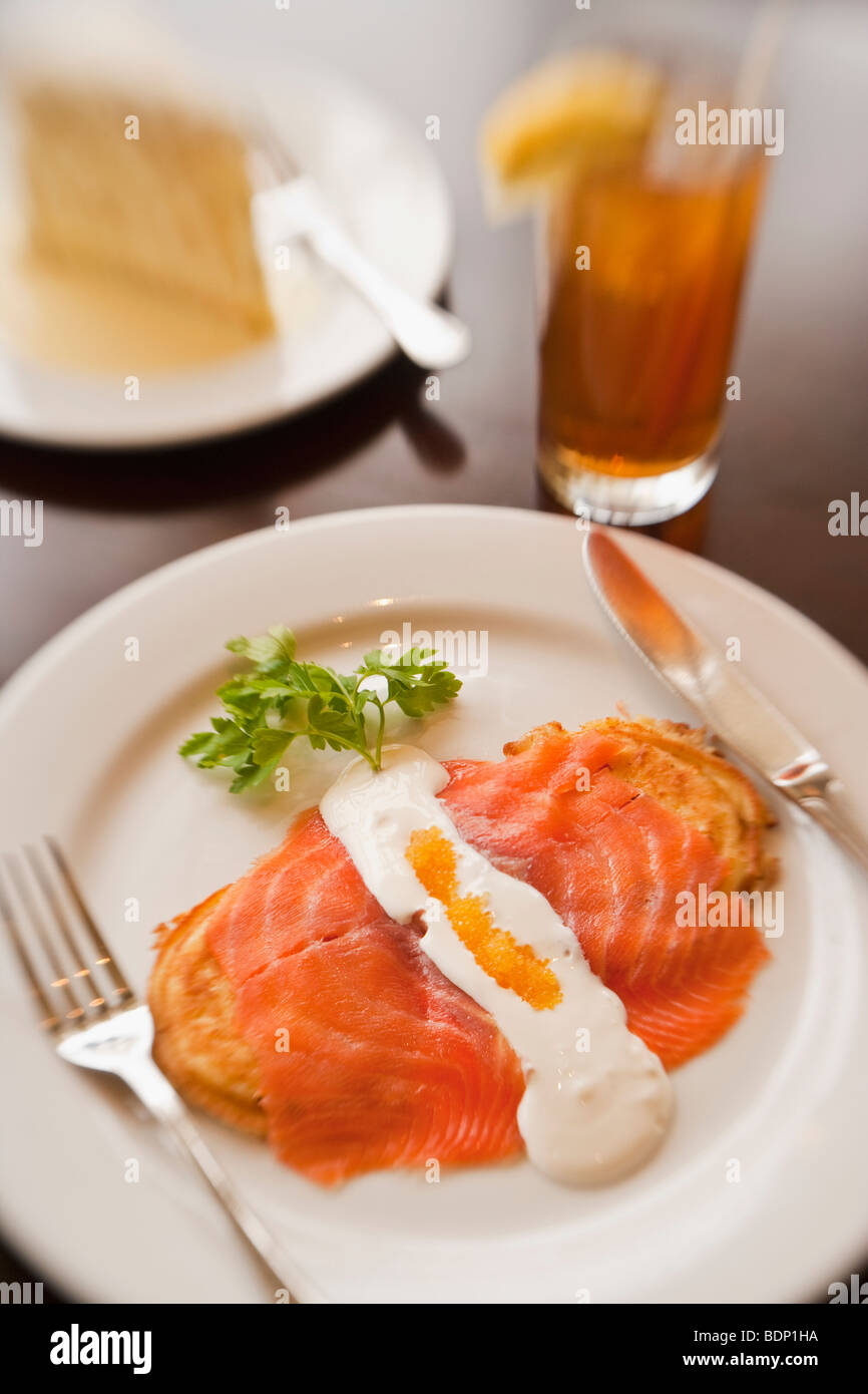 goat cheese pancakes, smoked salmon and golden caviar with iced tea and coconut cake, Restaurant Jane, Santa Barbara, - Stock Image