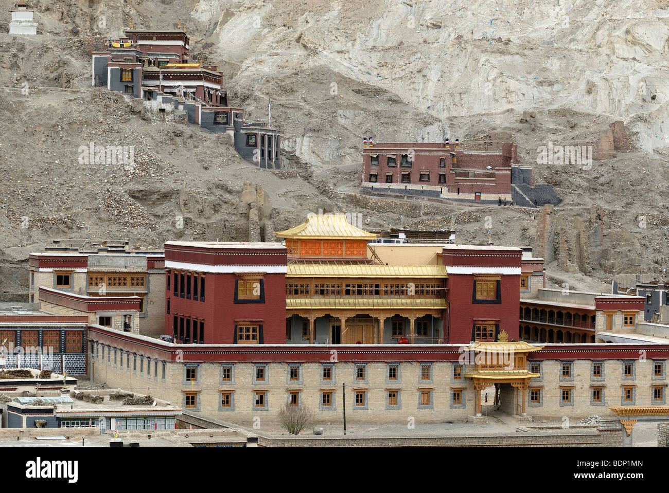 Tibetan temple and monastery complex in Sakya architectural style and painting on the mountainside, Sakya, Central - Stock Image