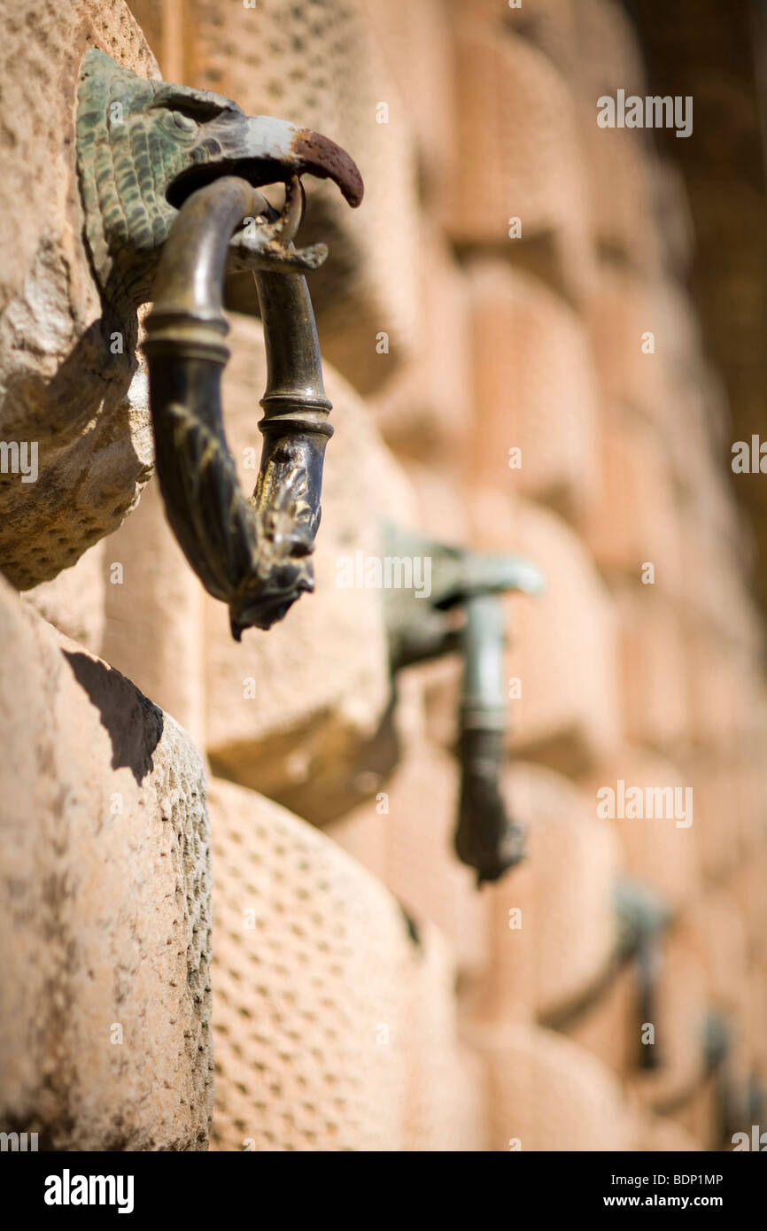 Rings hanging from eagle beaks, ornament on the wall of the Palace of Charles V, Granada, Spain - Stock Image