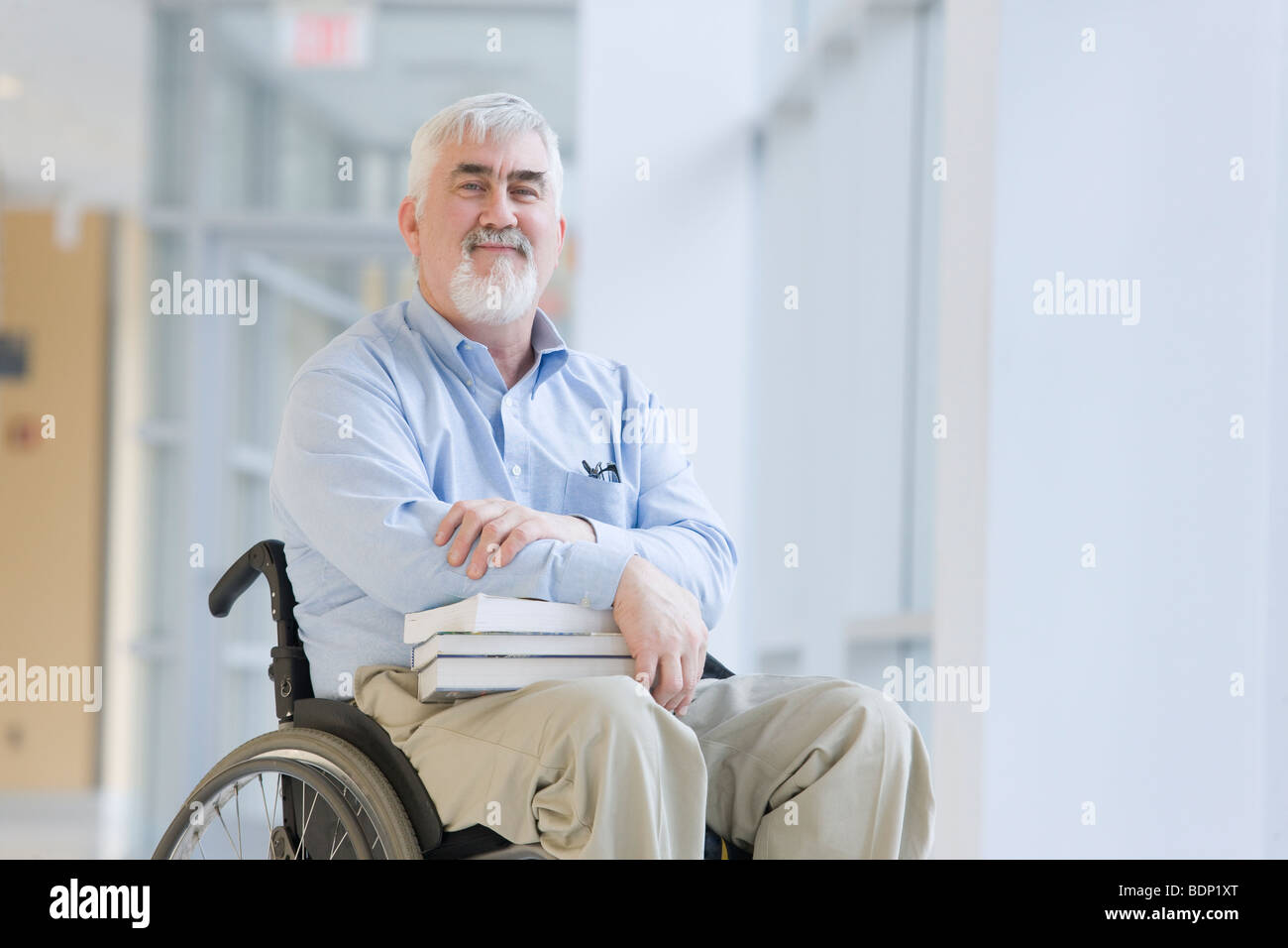 Portrait of a professor sitting in a wheelchair - Stock Image