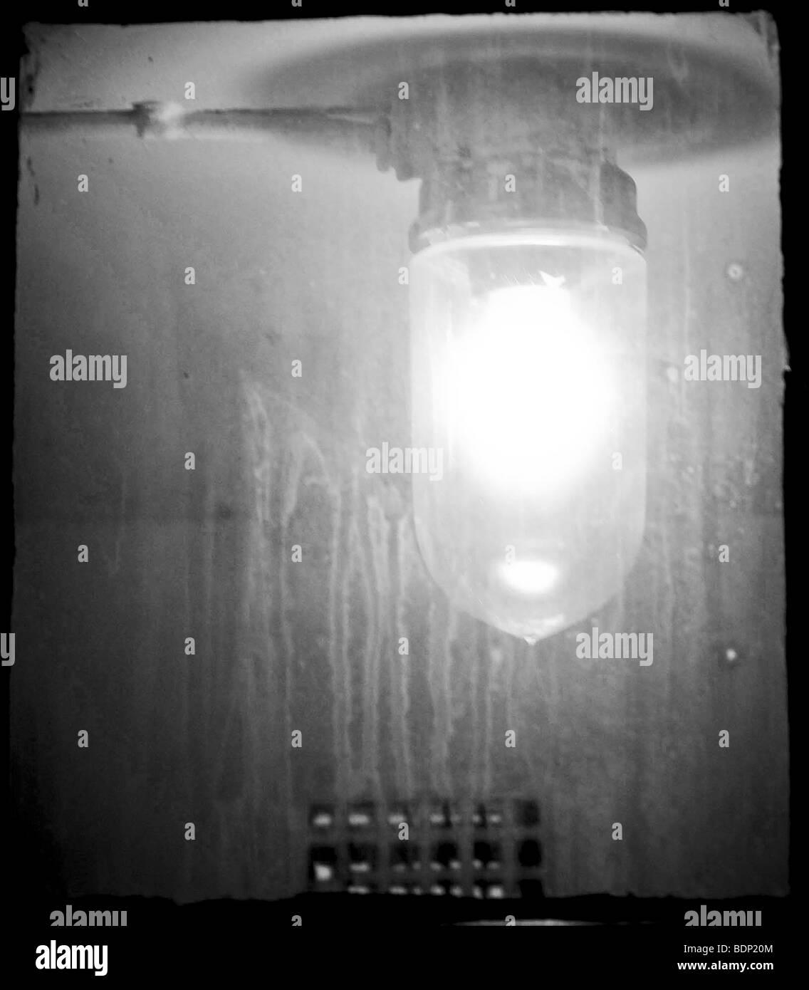 An illuminated electric light - Stock Image