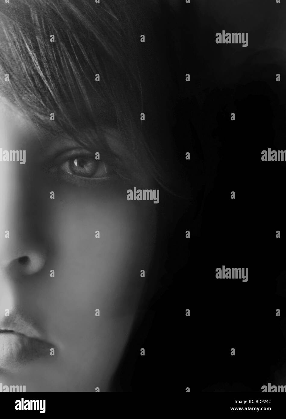 Close up of a young girls face looking at camera Stock Photo