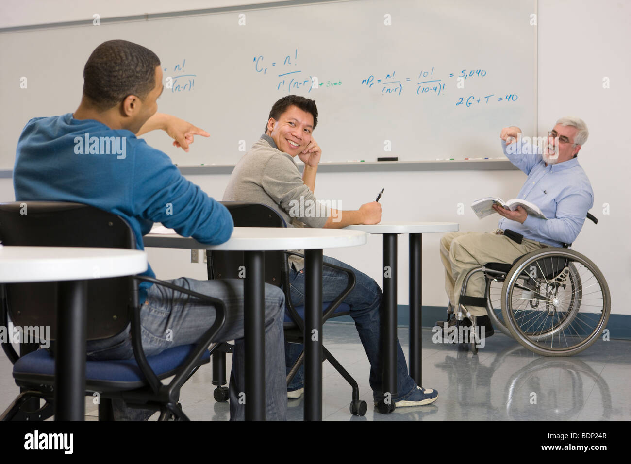 University professor pointing at a student in a classroom - Stock Image