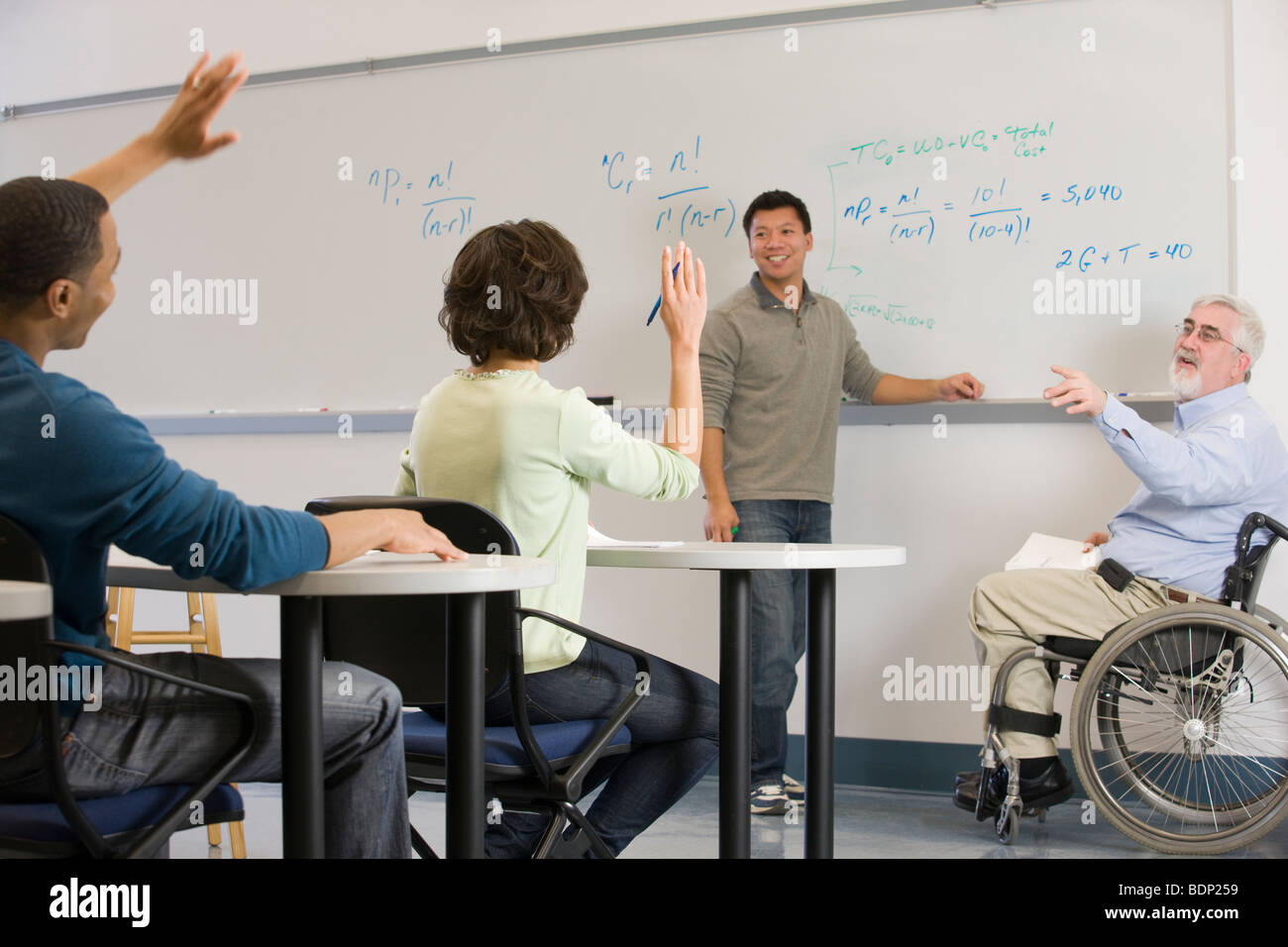 University professor asking to his students in a classroom - Stock Image