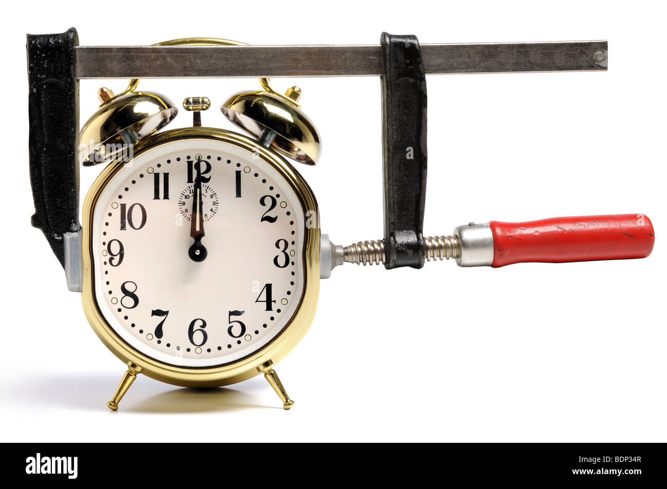 Pressed by time concept symbolized by press and time clock - Stock Image