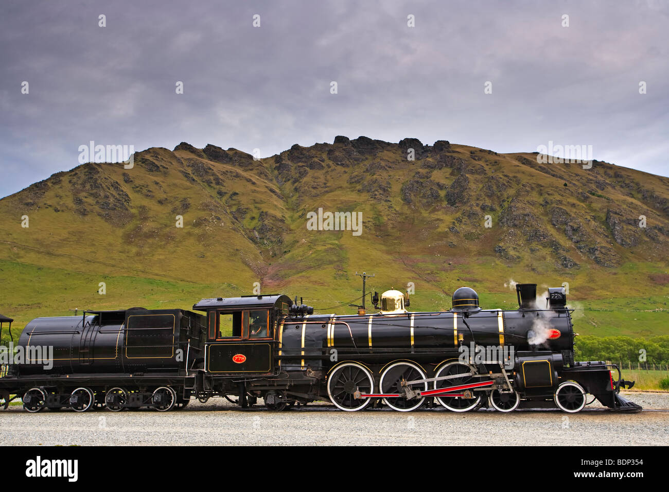 Kingston Flyer, a steam train built in 1925, at the Fairlight Station in Central Otago, South Island, New Zealand. Stock Photo