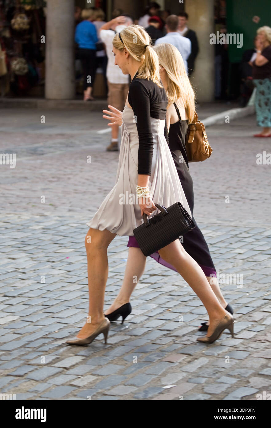 Glamorous Ladies on their way for a night out - Stock Image