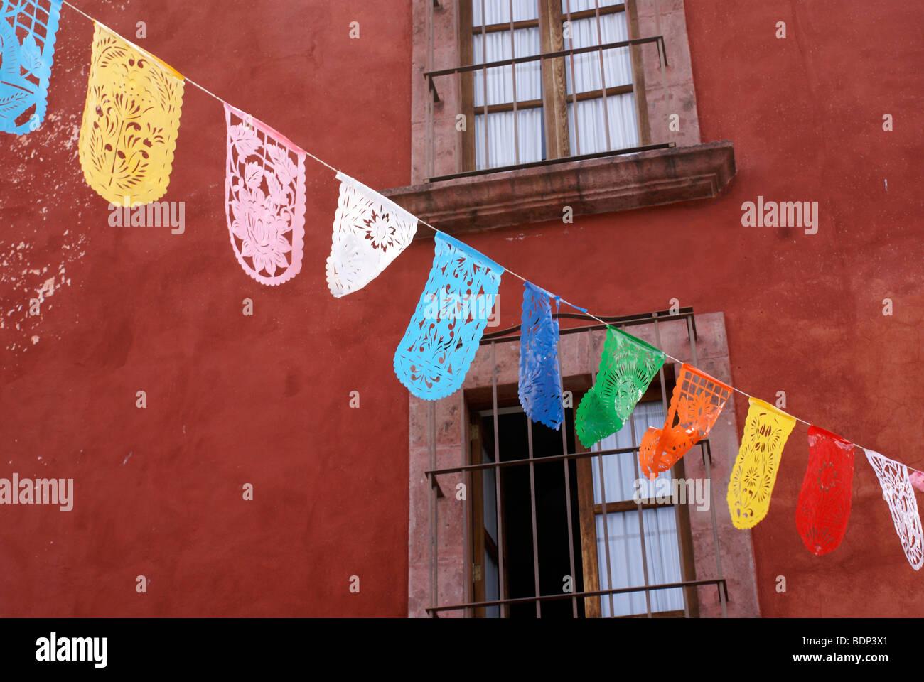 Colorful Mexican papel picado cutouts decorating a street in San Miguel de Allende, Mexico - Stock Image