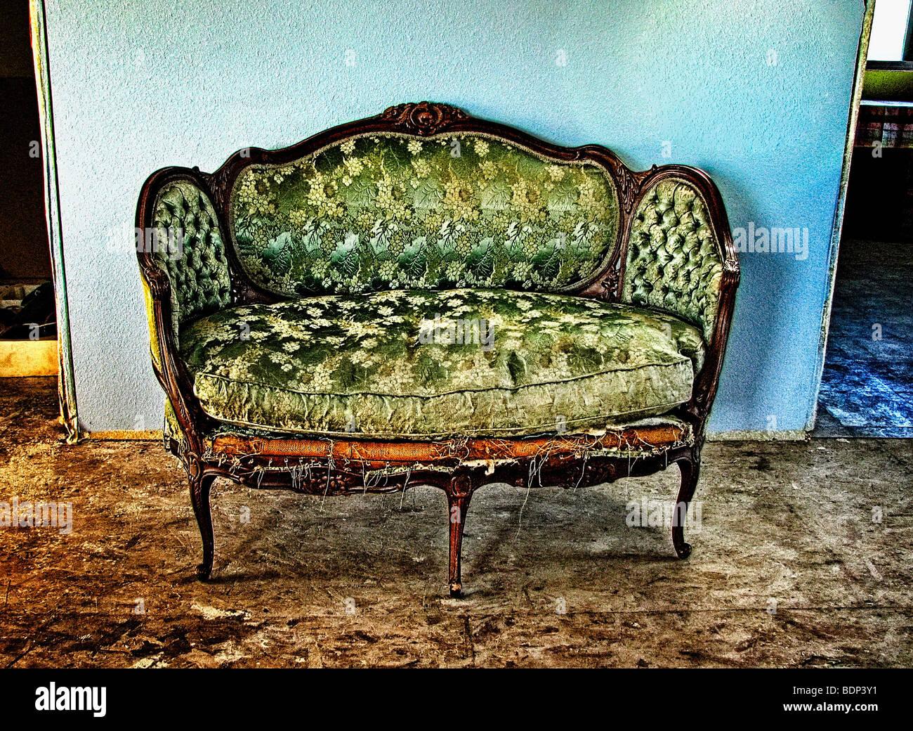 An old tatty sofa - Stock Image