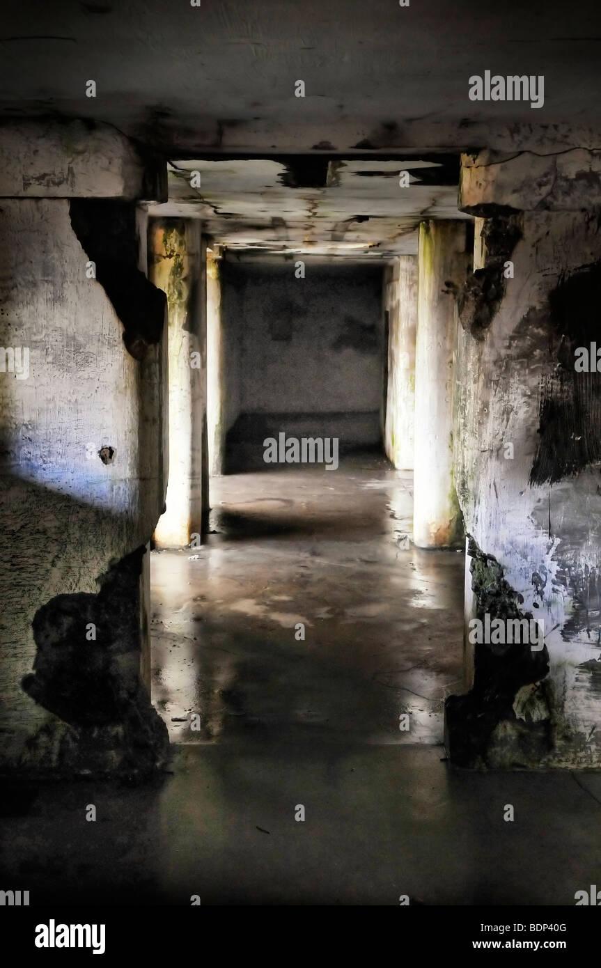 A dark wet underground hallway in decay - Stock Image