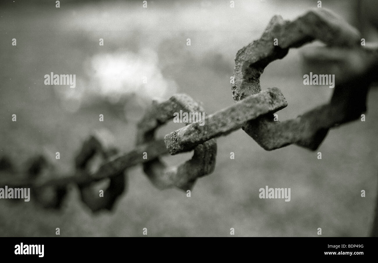 A rusty old chain linked fence - Stock Image