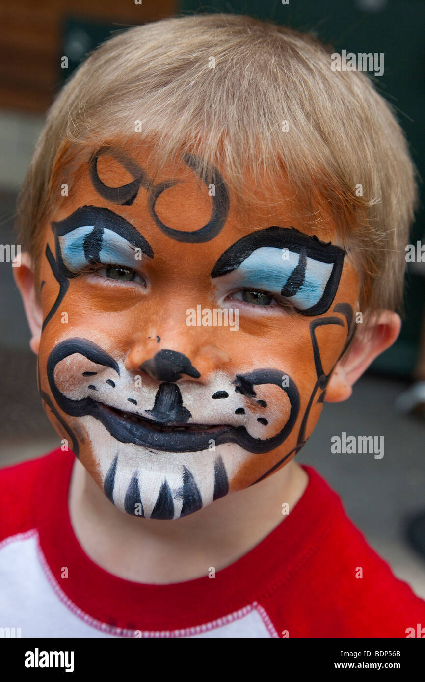 Face Painted Boy at the Bronx Zoo in New York City - Stock Image
