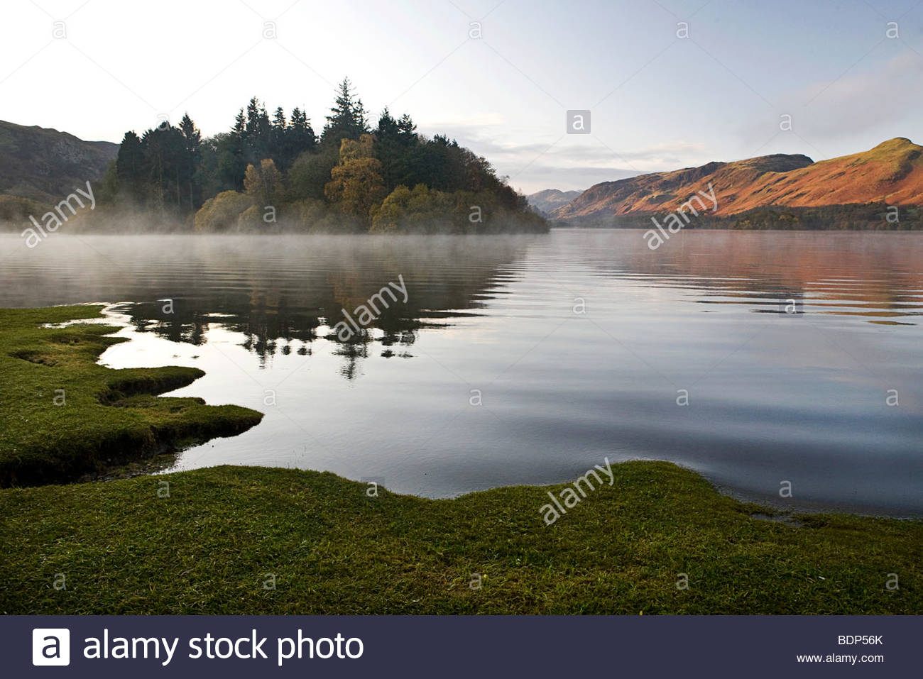 Landscape reflected in the rippling water of a lake - Stock Image