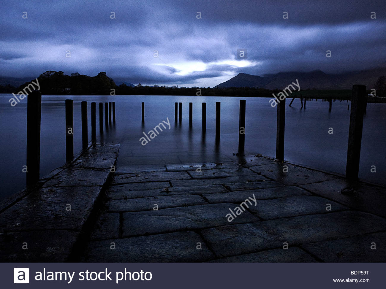A nightime view across a lake - Stock Image