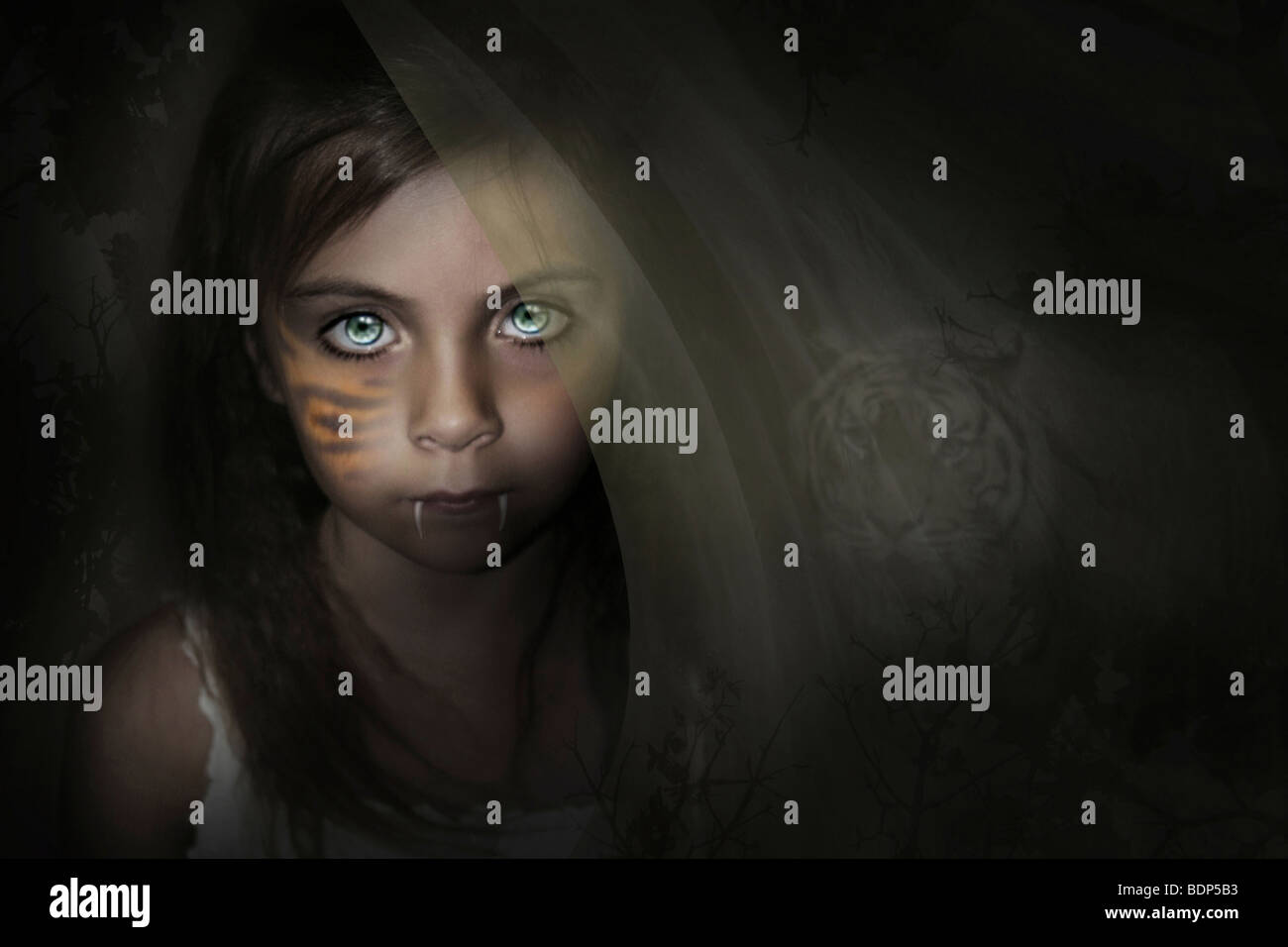 Fantasy image with young child with fangs and a tiger in the background behind her. - Stock Image
