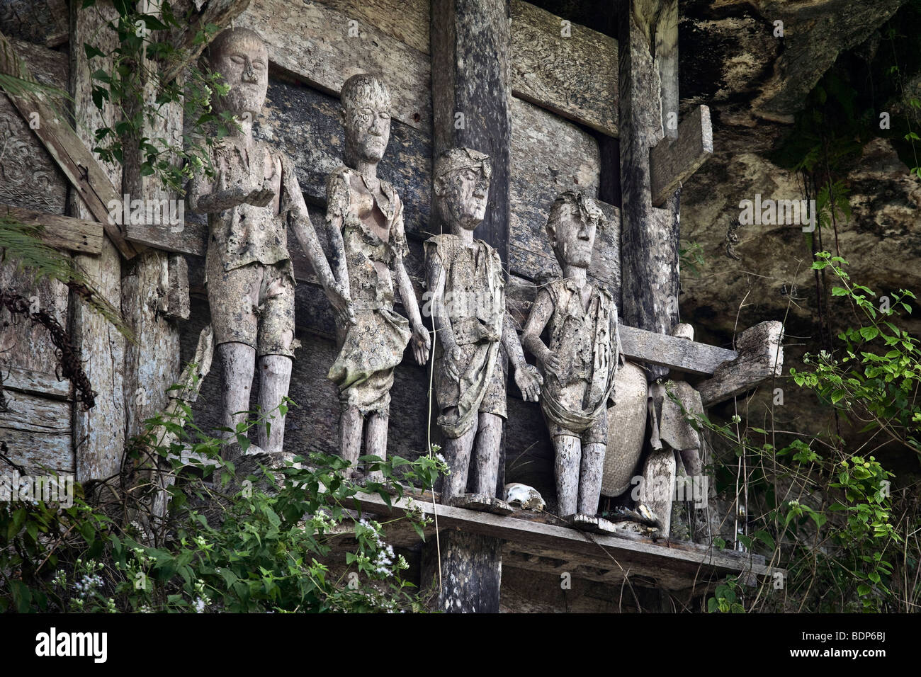 Indonesia, Sulawesi, Tana Toraja area, Marante village, stone graves with wooden effigies of the dead known as tau Stock Photo