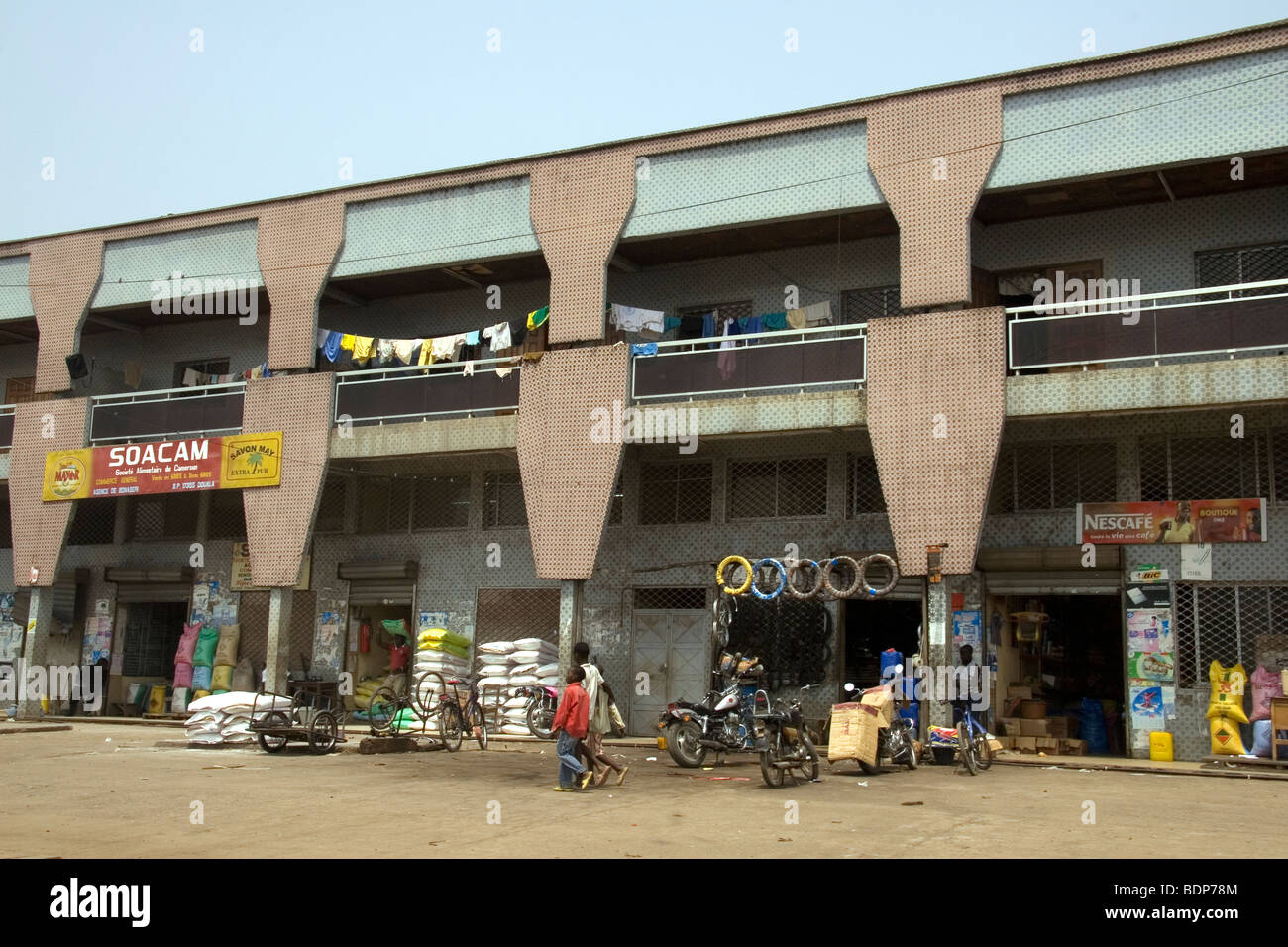 Modern building housing small businesses in Bonaberi district Douala Cameroon - Stock Image