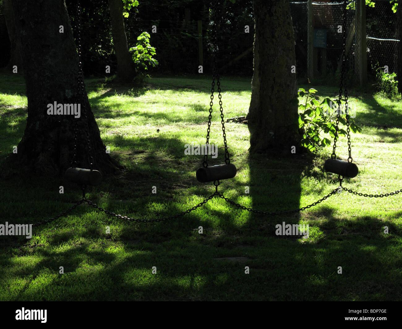 Playground swings - Stock Image