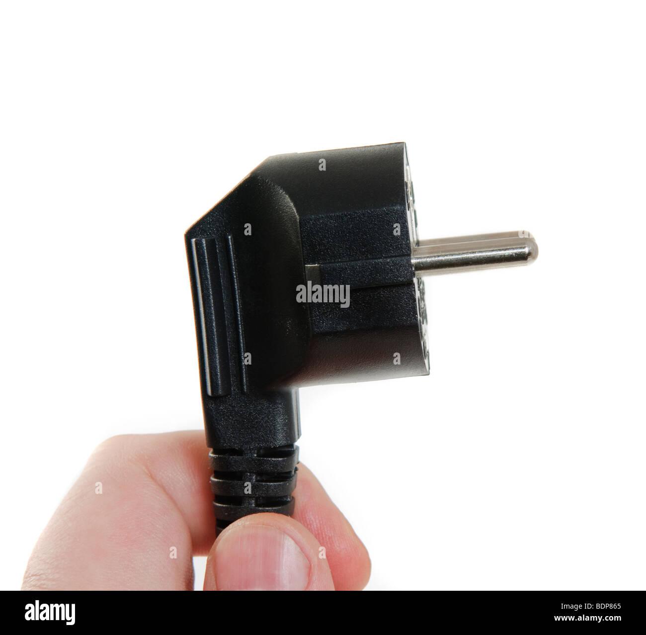 holding power plug, isolated on white background Stock Photo