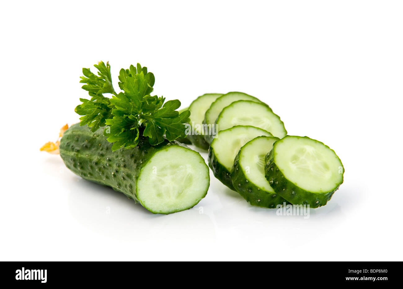 Cucumber slices isolated over white background. - Stock Image