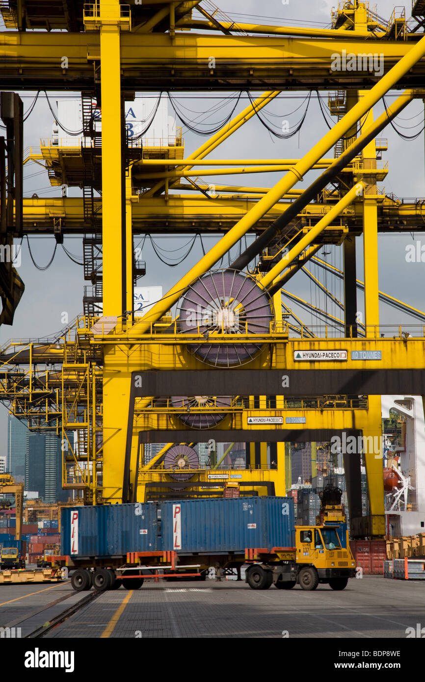 Container port cranes spool cable cabling truck - Stock Image